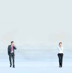 Business couple standing aside