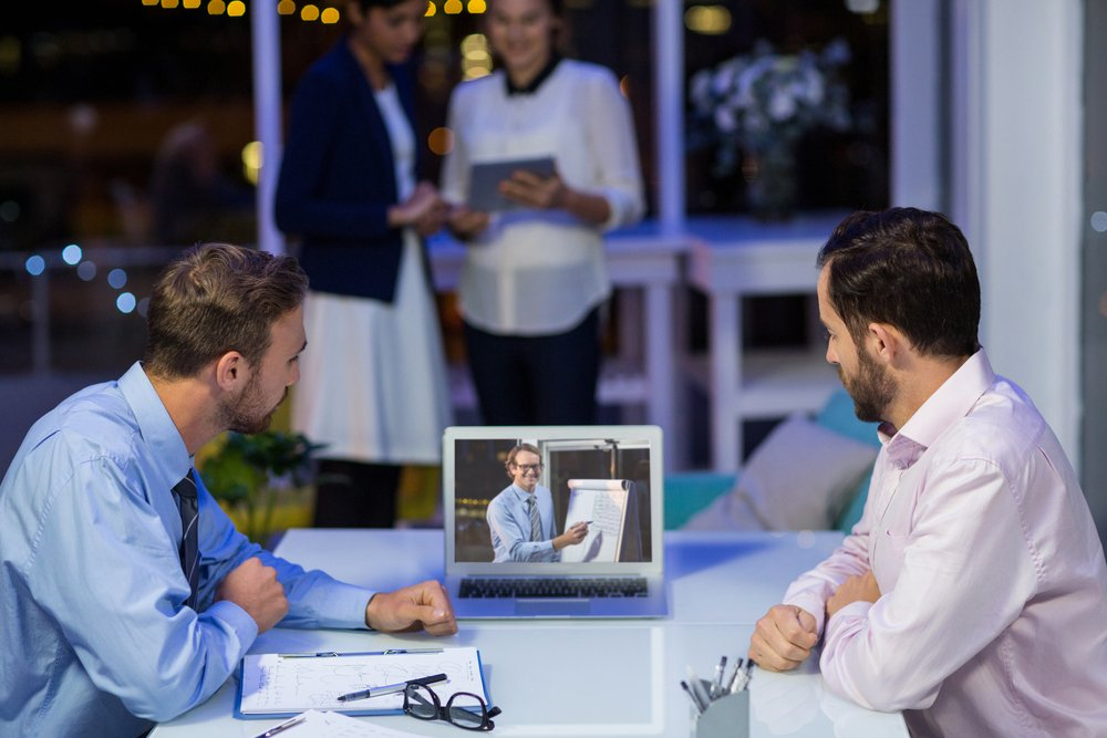 Businessmen having video conference in conference room at office